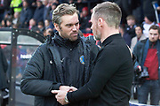 Salford City manager Graham Alexander and Macclesfield Town manager Daryl McMahon shaking hand before the EFL Sky Bet League 2 match between Salford City and Macclesfield Town at the Peninsula Stadium, Salford, United Kingdom on 23 November 2019.