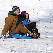 Young and old alike sledding in Central Park after New York City was hit with over 7 inches of snow during its first winter storm of the year. Central Park, Manhattan, New York, USA. 4th January 2014 Photo Tim Clayton