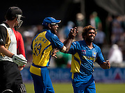 Bowler Lasith Malinga (right) celebrates with Angelo Mathews after the run out of Kyle Mills (left) and winning the ICC World Twenty20 Cup match between New Zealand and Sri Lanka at Trent Bridge. Photo © Graham Morris (Tel: +44(0)20 8969 4192 Email: sales@cricketpix.com)