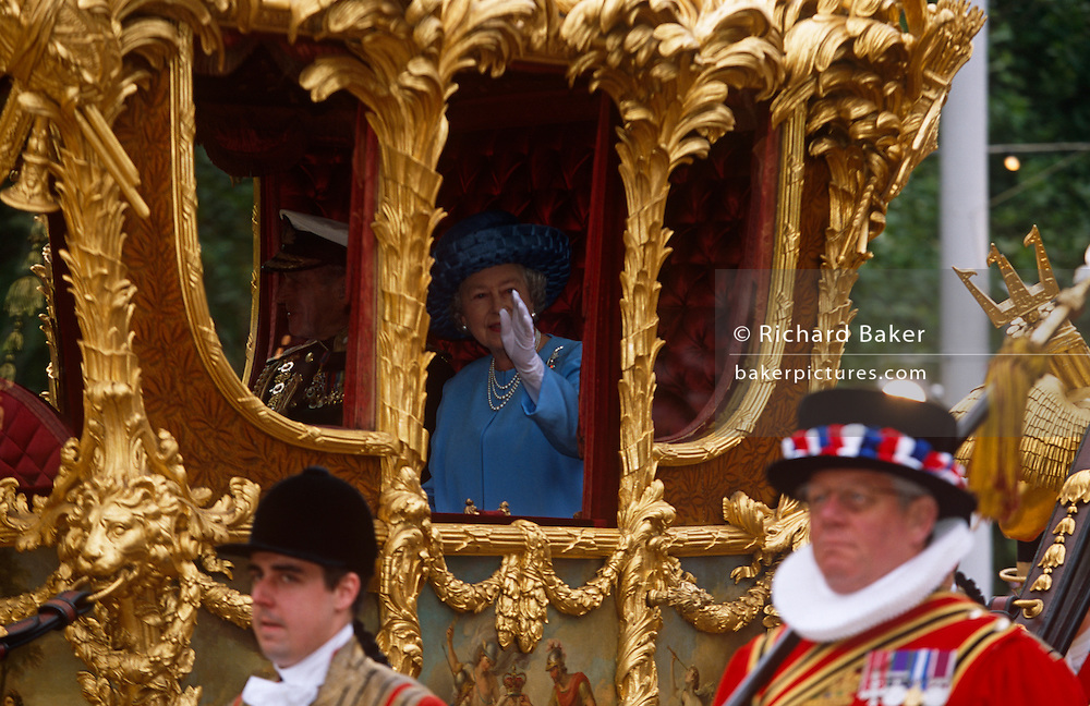 Queen Elizabeth II makes her way down the Mall with Prince Phillip for a Golden (50th anniversary) Jubilee...http://www.londononline.co.uk/monarchy/Royal_State_Coach/