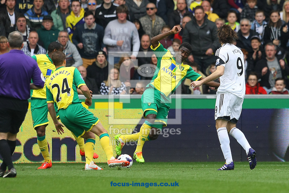 Alexander Tettey of Norwich and Ryan Bennett of Norwich combine to block a shot by Michu of Swansea during the Barclays Premier League match at the Liberty Stadium, Swansea<br /> Picture by Paul Chesterton/Focus Images Ltd +44 7904 640267<br /> 29/03/2014
