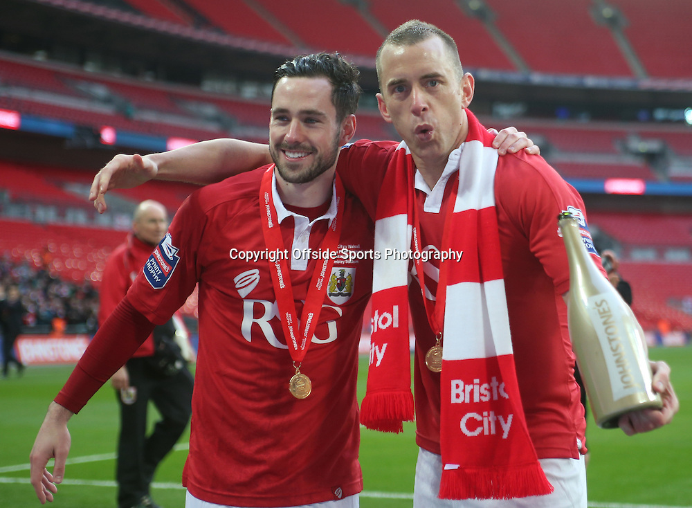 22 March 2015 - Johnstones Paint Trophy Final - Bristol City v Walsall - Greg Cunningham and Aaron Wilbraham celebrate winning the JPT.<br /> <br /> Photo: Ryan Smyth/Offside