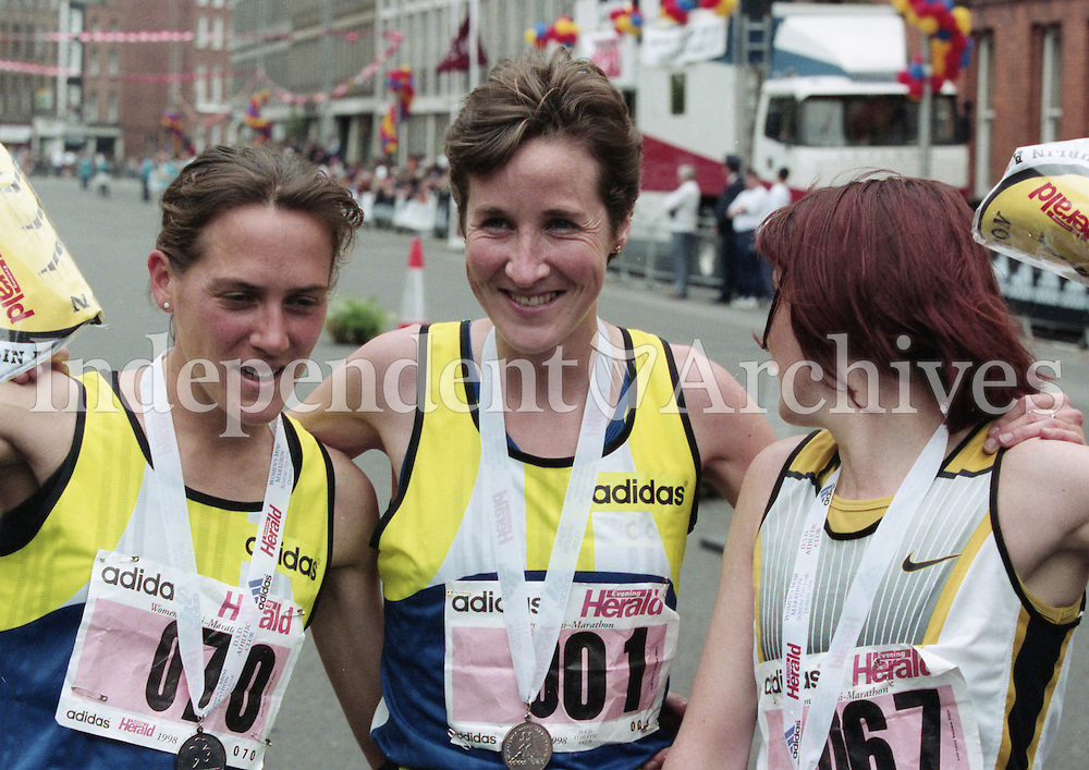 1998 Women's Mini Marathon sponsored by the Evening Herald, 7/6/98..<br /> At the finish line:<br /> Lucy Wright (3rd place, from Leeds), Catherina McKiernan (1st) and Teresa Duffy (2nd, from Belfast).<br /> (Part of the Independent Newspapers Ireland/NLI Collection).