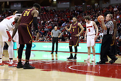 10 January 2018:  Gerry Pollard handles lane duties during a foul shot during a College mens basketball game between the Loyola Chicago Ramblers and Illinois State Redbirds in Redbird Arena, Normal IL