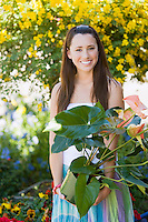 Young Woman in Garden with Plant