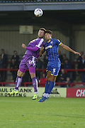 Will Nightingale AFC Wimbledon and Ryan Brunt tussles during the Johnstone's Paint Trophy match between AFC Wimbledon and Plymouth Argyle at the Cherry Red Records Stadium, Kingston, England on 1 September 2015. Photo by Stuart Butcher.