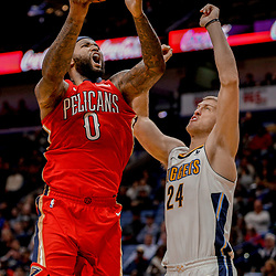 Dec 6, 2017; New Orleans, LA, USA; New Orleans Pelicans center DeMarcus Cousins (0) shoots over Denver Nuggets center Mason Plumlee (24) during the second half at the Smoothie King Center. The Pelicans defeated the Nuggets 123-114. Mandatory Credit: Derick E. Hingle-USA TODAY Sports