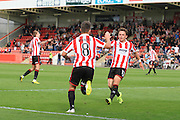 Billy Waters celebrates his goal with Jack Munns during the Vanarama National League match between Cheltenham Town and Dover Athletic at Whaddon Road, Cheltenham, England on 12 September 2015. Photo by Antony Thompson.