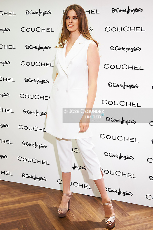 Australian Model Robyn Lawley poses for photographers as new image of Couchel at Corte Ingles Center on September 8, 2015 in Madrid