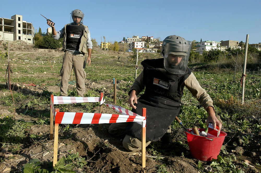 Deminers from Mines Advisory Group (MAG) clearing some of the millions of cluster sub-munitions and other remnants of war scattered across southern Lebanon..Aadchit, Lebanon. 25/11/2008..Photo © J.B. Russell