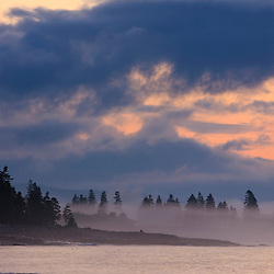 Morning clouds at dawn at Seawall in Maine's Acadia National Park.