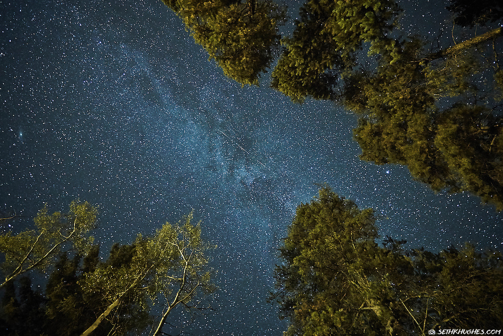 Looking up at a night sky full of stars in Jasper National Park, Alberta, Canada.