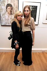Left to right, SCARLETT CARLOS CLARKE and ANOUSKA BECKWITH at a private view of 'Most Wanted' an exhibition of photographs held at The Little Black Gallery, Park Walk, London on 27th November 2008.