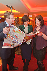 Grant Thornton Chinese Language class at Wong Tings Sheffield..Grant Thornton Partner Paul Houghton with tutor Jinping Xit and Claire Davis taking a look at a Chinese Newspaper..http://www.pauldaviddrabble.co.uk.8  March 2012 .Image © Paul David Drabble