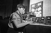 "Jamboree of the Air for Catholic Boy Scouts of Ireland.  Picture shows Patrol Leader Geoffrey O'Sullivan of the Donnybrook Unit, Catholic Scouts of Ireland, calling ""C-O Jamboree"" during the ""Jamboree of the Air"". The Jamboree is a link up of the world's ten million scouts with the aid of amateur radio operators..22.10.1966"