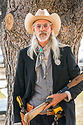 An old cowboy dressed as an old west lawman during Cheyenne Frontier Days July 25, 2015 in Cheyenne, Wyoming. Frontier Days celebrates the cowboy traditions of the west with a rodeo, parade and fair.