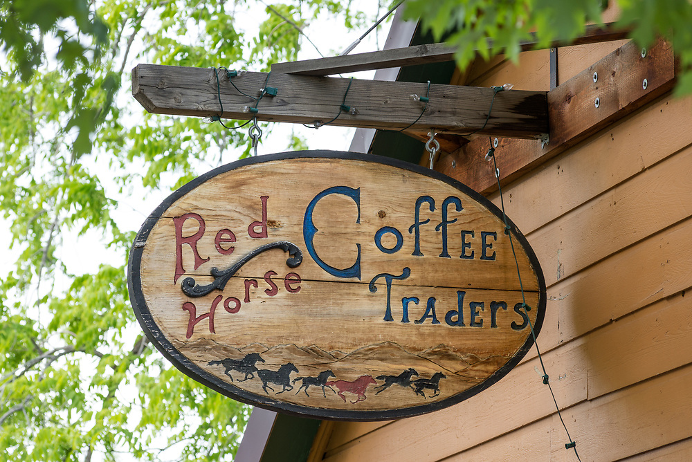 Artistic wood sign outside Red Horse Coffee Traders in Joseph, Oregon.