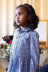 Caught in a pensive moment, four-year-old Alannah George who has an IQ of 140 and taught herself to read at two-and-a-half, is a member of Mensa. Iver, Buckinghamshire, March 10 2019.