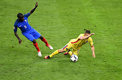 Gabriel Torje of Romania is fouled by Ngolo Kante of France  - Mandatory by-line: Joe Meredith/JMP - 10/06/2016 - FOOTBALL - Stade de France - Paris, France - France v Romania - UEFA European Championship Group A