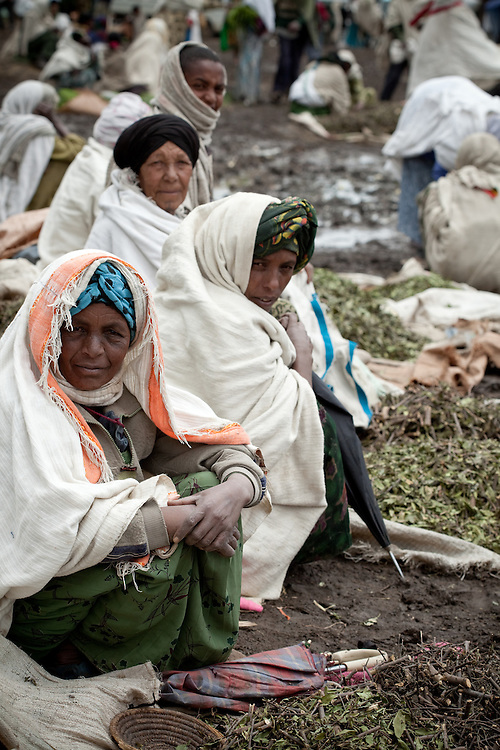 Women sell spices on Market day in Mehal Meda on the Guassa Plateau in the Ethiopian Highlands