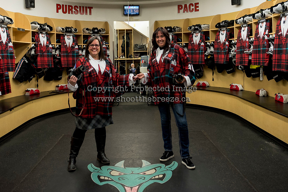 KELOWNA, CANADA - MARCH 10: Kelowna Rockets team photographers Cindy Rogers and Marissa Baecker pose in the dressing room wearing Don Cherry jerseys on March 10, 2018 at Prospera Place in Kelowna, British Columbia, Canada.  (Photo by Marissa Baecker/Shoot the Breeze)  *** Local Caption ***