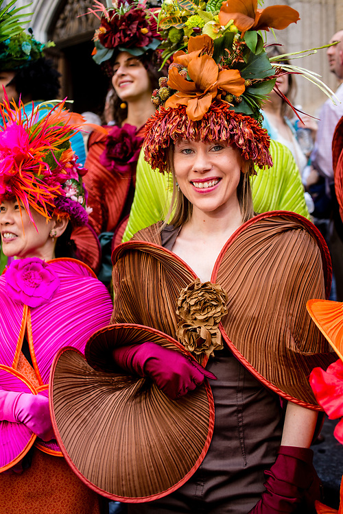 New York, NY - April 16, 2017. A member of a group calling themselves The City Chicks, all of whom wore hats designed by Trapani and wraps designed by Alexandra Tsoukala at New York's annual Easter Bonnet Parade and Festival on Fifth Avenue.