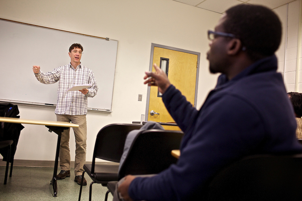 Greg Wahl, left, associate professor at Montgomery College, answers questions from students in his Basic Writing II class, including Kenneth Okorafor, before students formed groups to begin work on their final project for class. If students pass this class, it allows them to progress to the college level english program. Otherwise students will face the decision to take the remedial class again or drop out.