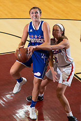 Kentucky Girls All-Star Erin Boley, left drives to the basket with pressure from Indiana Girls All-Star Lindsey Corsair in the first half. Boley who was crowned Miss Kentucky would pull a muscle and miss the second half. The Kentucky vs. Indiana All-Star Classic was held, Sunday, June 12, 2016 at Knights Hall in Louisville.