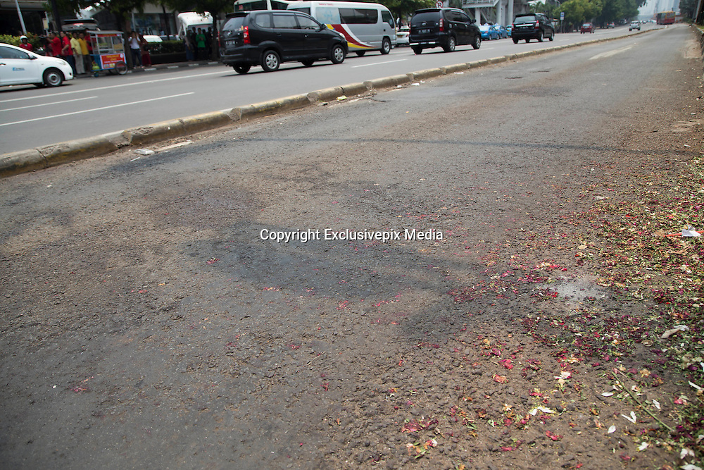 Jakarta, Indonesia 17 January 2016 : <br /> <br /> Flowers on the street where the bomb exploded. Jakarta back to normal again after the fatal attack at Starbuck Coffee at Thamrin Street. Peoples still visiting to the bombing site to take photos and condemn to the terrorist action.<br /> ©Exclusivepix Media