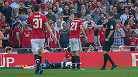 Football - 2018 FA Cup Final - Chelsea vs. Manchester United<br /> <br /> Referee Michael Oliver points to the spot as Phil Jones (Manchester United) sits dejectedly at Wembley Stadium.<br /> <br /> COLORSPORT/DANIEL BEARHAM