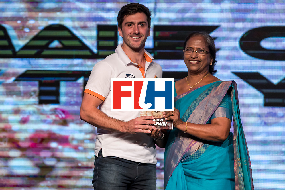 CHANDIGARH, INDIA - FEBRUARY 23: Winner of the FIH Female Coach of the Year Karen Brown of England award received by Adam Dixon [L] presented by Mariamma Koshy [R], President of Hockey India during the FIH Hockey Stars Awards 2016 at Lalit Hotel on February 23, 2017 in Chandigarh, India. (Photo by Ali Bharmal/Getty Images for FIH)