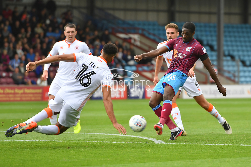 Scunthorpe United midfielder Hakeeb Adelakun (16) takes shot at goal  during the EFL Sky Bet League 1 match between Scunthorpe United and Blackpool at Glanford Park, Scunthorpe, England on 9 September 2017. Photo by Ian Lyall.