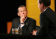 28 August 2007: Seven-time Tour de France winner Lance Armstrong (left) listens to Republican presidential hopeful and Senator Sam Brownback (R-KS) (right) answer a question at the LIVESTRONG Presidential Cancer Forum in Cedar Rapids, Iowa on August 28, 2007.