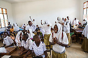 Students celebrate completing their project at Mingoyo school as part of the VSO / ICS Elimu Fursa project (Opportunities in Education) Lindi, Lindi region. Tanzania.