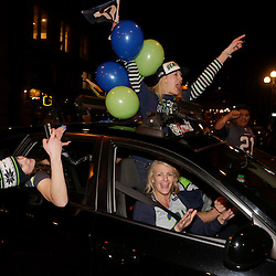 Seattle Seahawks celebrate in the streets after their team won Super Bowl XLVIII in Seattle, Washington February 2, 2014. The Seahawks beat the Denver Broncos 43-8 for their first NFL championship Sunday in East Rutherford, New Jersey.  REUTERS/Jason Redmond  (UNITED STATES)