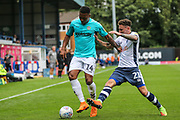 Forest Green Rovers Tahvon Campbell(14) is tackled by Bury's Callum McFadzean during the EFL Sky Bet League 2 match between Bury and Forest Green Rovers at the JD Stadium, Bury, England on 18 August 2018.
