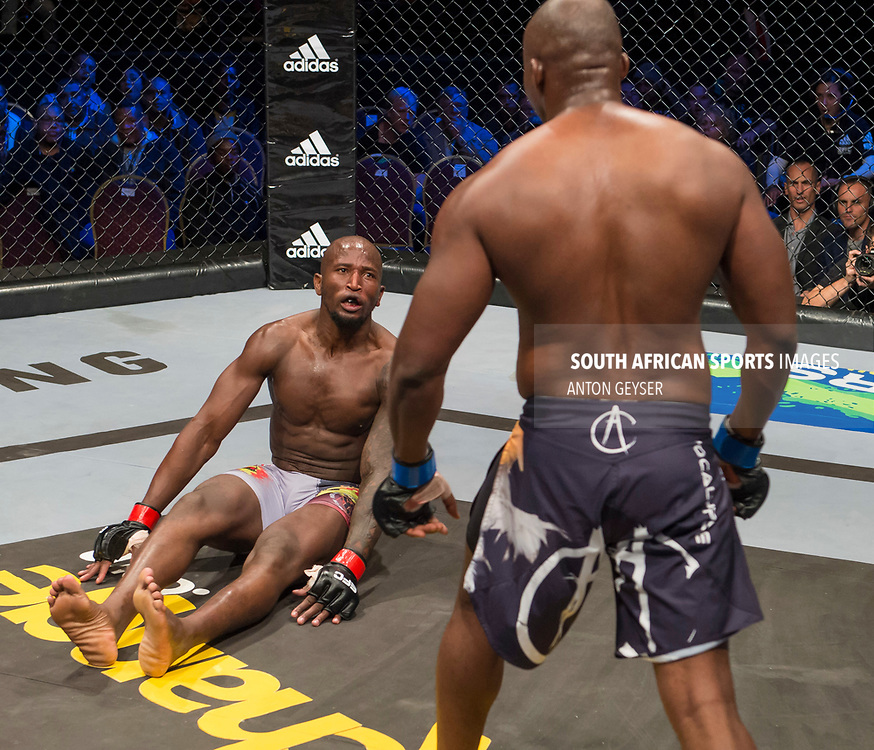 JOHANNESBURG, SOUTH AFRICA - MAY 13: (R-L) Ricky Misholas drops Thabani Mndebela during EFC 59 Fight Night at Carnival City on May 13, 2017 in Johannesburg, South Africa. (Photo by Anton Geyser/EFC Worldwide/Gallo Images)