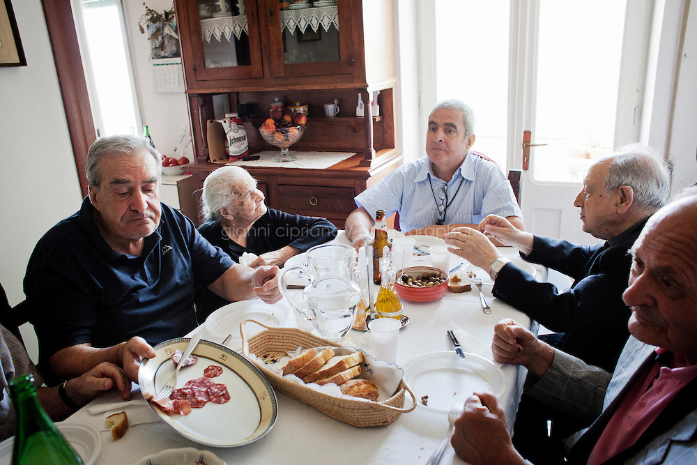 PERDASDEFOGU, SARDINIA, ITALY - 30 JUNE 2013: The Melis family and their guest have lunch togeter to celebrate the 100th birthday of Claudina Melis (second from left) in Perdasdefogu, Italy, on June 30th 2013.<br /> <br /> Last year, the Melis family entered the Guinness Book of World Records for having the highest combined age of any nine living siblings on earth &mdash; today more than 825 years. The youngest sibling, Mafalda &ndash; the &quot;little one&quot; &ndash; is 79 years old.<br /> <br /> The Melis siblings were all born in Perdasdefogu to Francesco Melis and Eleonora Mameli, who had a general store. Consolata, 106, is the oldest, then Claudia, 100; Maria, 98; Antonino, 94; Concetta, 92; Adolfo, 90; Vitalio, 87; Fida Vitalia, 81; and Mafalda, the baby at 79. Their descendants now account for about a third of the village.
