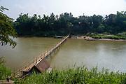 Bamboo bridge crossing the Nam Khan River, Luang Prabang, Laos.