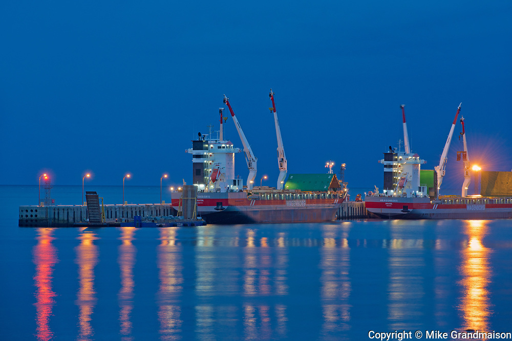 Reflections  of ship at dock in the North Shore of the Gulf of St. Lawrence<br />