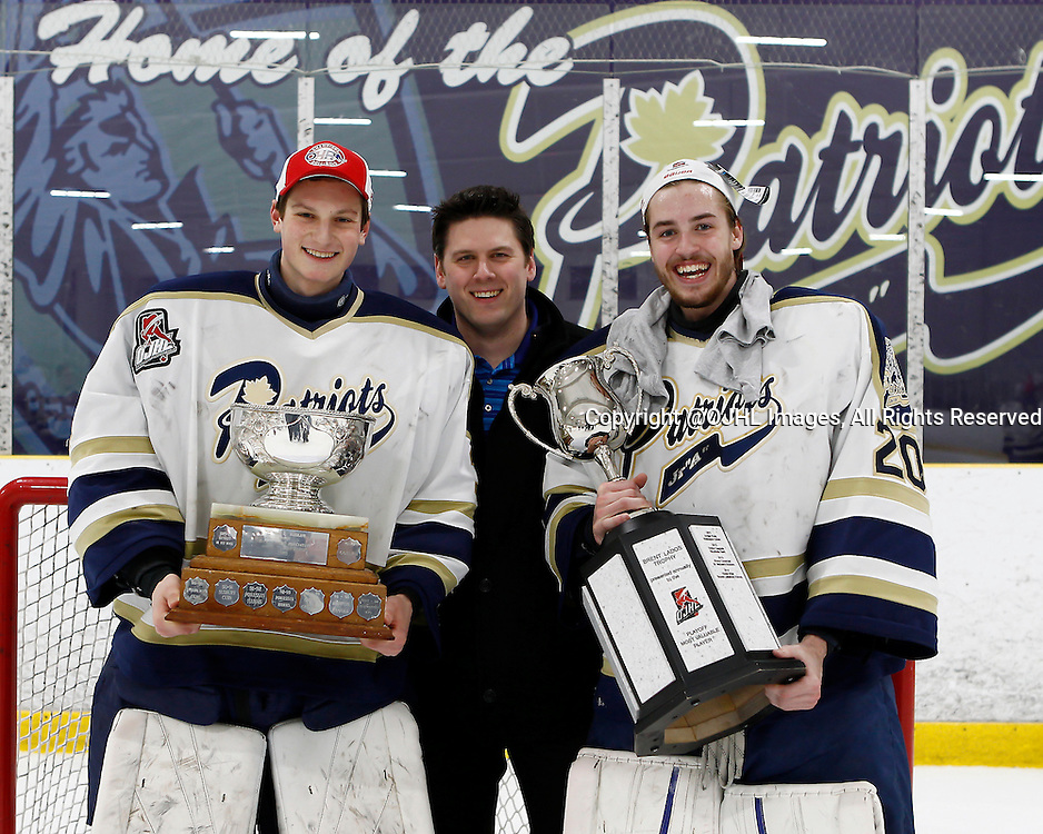 TORONTO, ON - Apr 22, 2015 : Ontario Junior Hockey League game action between the Kingston Voyageurs and the Toronto Patriots. Game seven of the Buckland Cup Championship Series. Emanuel Vella #30 and Mathew Robson #20 pose with the Buckland Cup and Brent Ladds Trophy.<br /> (Photo by Brian Watts / OJHL Images)