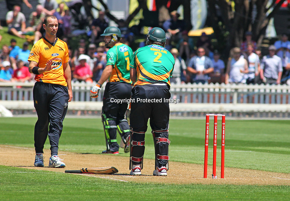 Andy Mckay Apologies to Matthew Sinclair during their Twenty20 Cricket match - HRV Cup, Wellington Firebirds v Central Stags, 27 December 2011, Hawkins Basin Reserve, Wellington. . PHOTO: Grant Down / photosport.co.nz