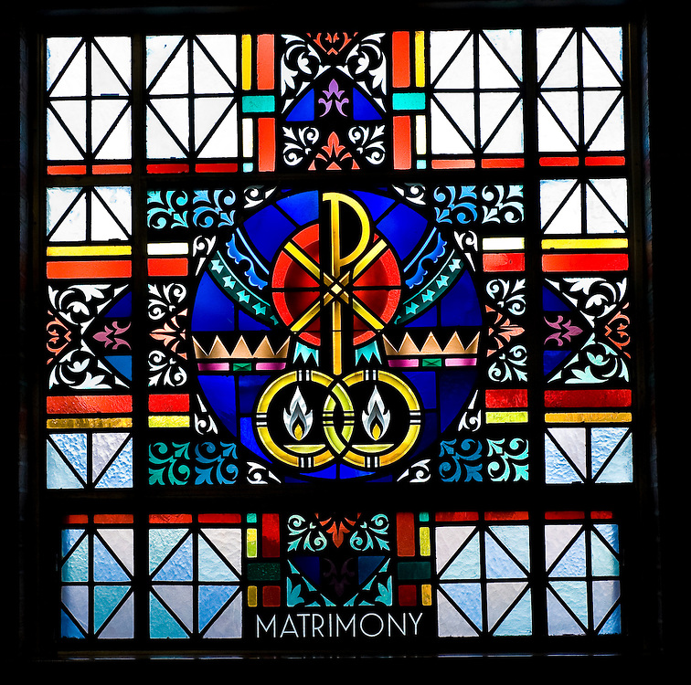 Stained glass image illustrating Sacrament of Matrimony at St. Mary Church in Peshtigo, Wis. (Sam Lucero photo)