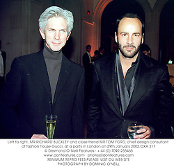 Left to right, MR RICHARD BUCKLEY and close friend MR TOM FORD, chief design consultant of fashion house Gucci, at a party in London on 29th January 2002.OXA 217