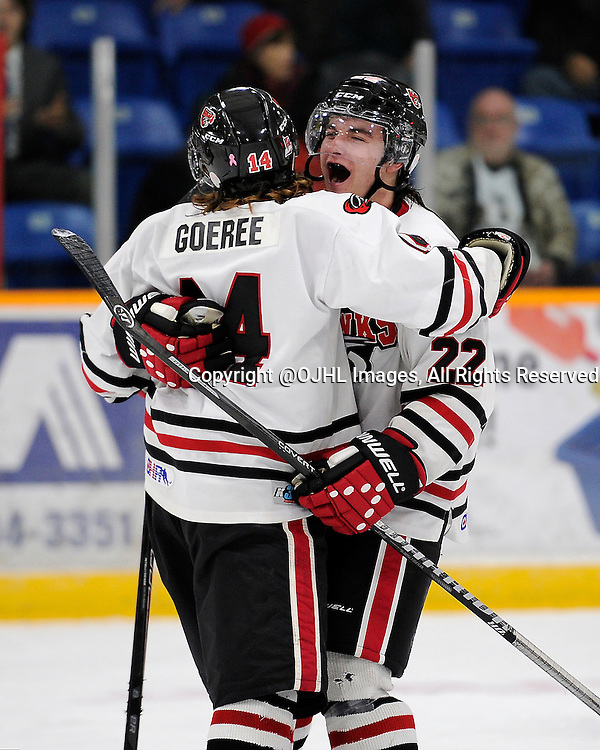 TRENTON, ON - Oct 10, 2014 : Ontario Junior Hockey League game action between Milton and Trenton, Kevin Fitzpatrick #22 of the Milton Ice Hawks celebrates the goal with teammate Josh Chiarot #24 of the Milton Ice Hawks<br /> (Photo by Amy Deroche/ OJHL Images)
