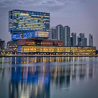 Cleveland Clinic Abu Dhabi in Sowwah Square Island during twilight period taken at long exposure.  From this angle and with all those glittering lights it just looks like a giant Pinball machine!