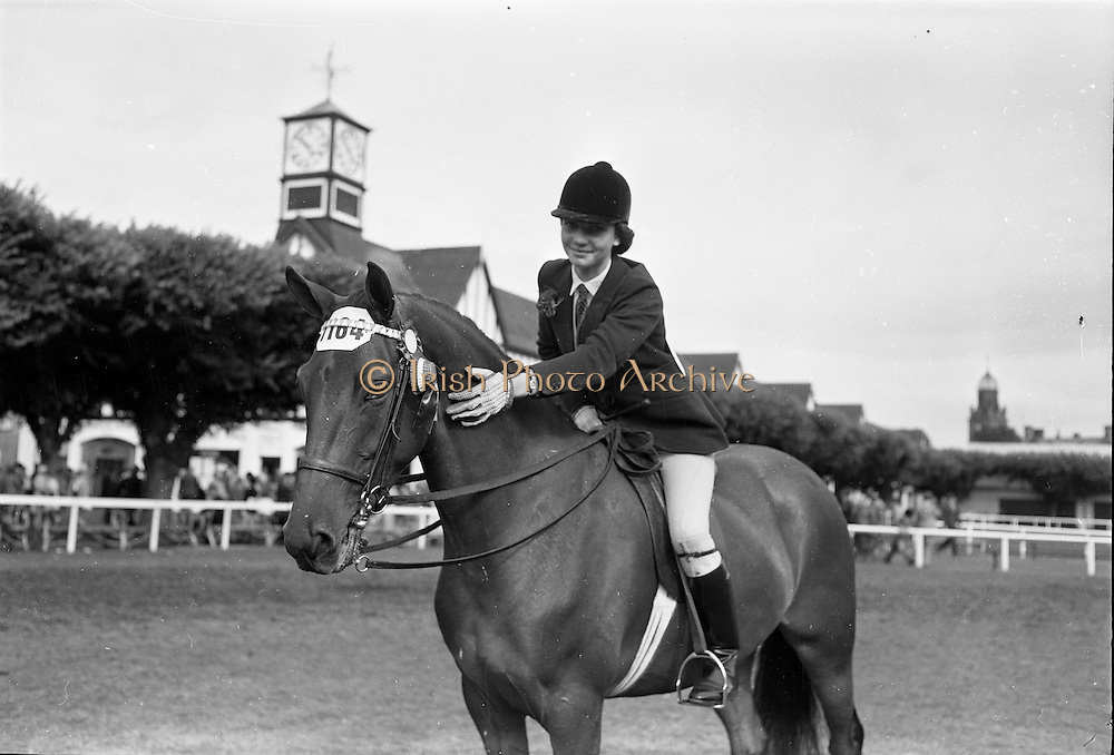 """08/08/1962<br /> 08/08/1962<br /> 08 August 1962<br /> Dublin Horse Show at the RDS, Ballsbridge, Wednesday. <br /> Picture shows """"Charm"""" a 4 year old brown mare owned by Mrs R. Carroll, South View, Killenaule, Co. Tipperary and shown by her 15 year old daughter Miss Vera Carroll, won the Childrens Champion Pony Award at the Dublin Horse Show."""