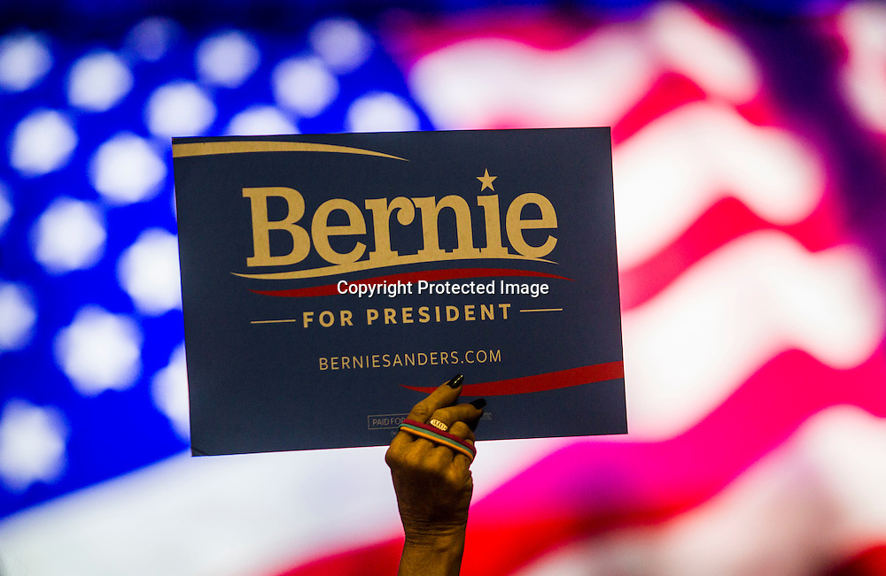 A supporter holds up a sign during a rally for democratic presidential candidate Sen. Bernie Sanders, I-Vt., Monday, Aug. 10, 2015, at the Los Angeles Memorial Sports Arena in Los Angeles. (AP Photo/Ringo H.W. Chiu)