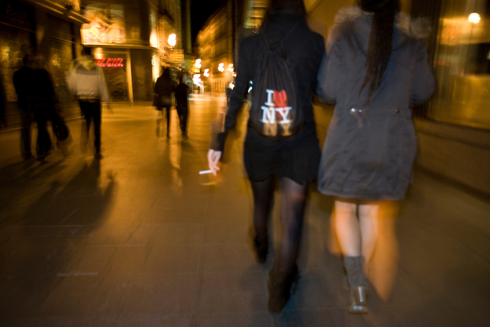 2:23 AM: Marta Selgas, 23, María Padín, 25, and Ángela Hermosa, 23, walk on the streets of Madrid, heading to the clubs..