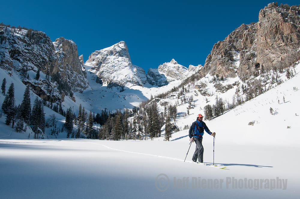 A young man ski-touring in Grand Teton National Park, Jackson Hole, Wyoming.